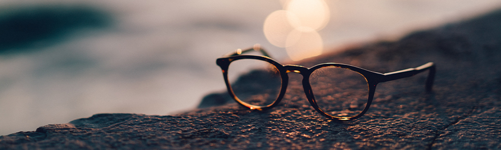 Glasses laying on a rock